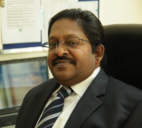Prof. Christopher Abraham